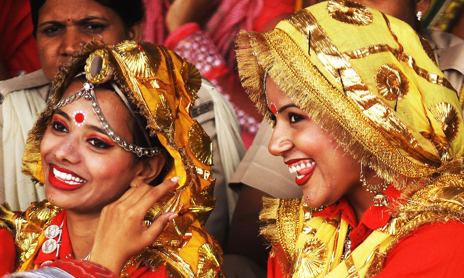 Participants share a moment after performing at a cultural program during India's Independence Day celebrations in Ajmer, in the desert state of Rajasthan, India, August 15, 2016. ─ Reuters