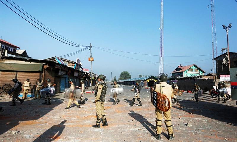 Indian policemen patrol on a street during a curfew in Srinagar, August 16.—Reuters