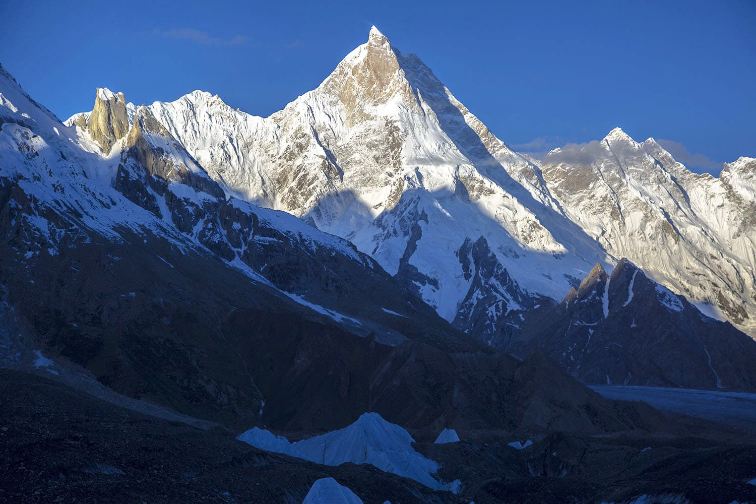 The first rays of the sun on the beautiful Masherbrum mountain.