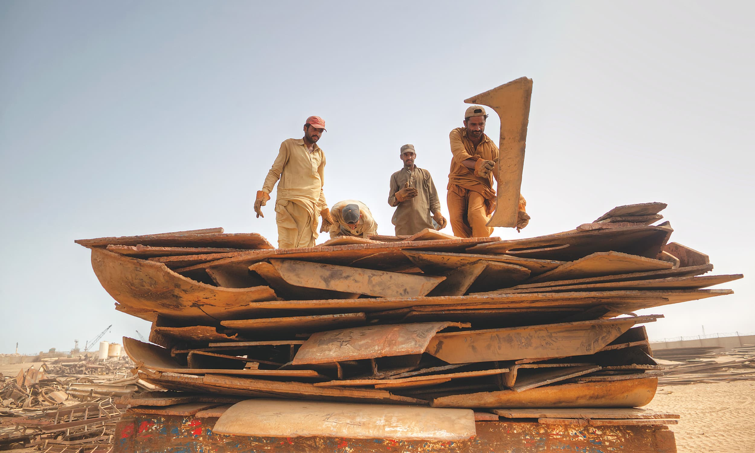 Labourers stack the remains of a ship onto a truck at Gadani, Balochistan | Kohi Marri