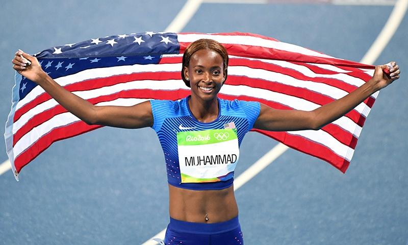 Dalilah Muhammad celebrates after she won the Women's 400m Hurdles Final.— AFP