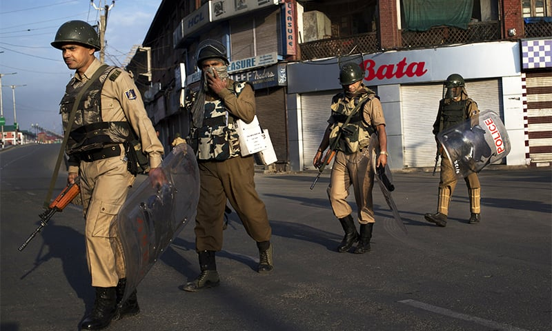 Indian paramilitary soldiers patrol during curfew in Srinagar, Indian-controlled Kashmir, Friday, August 19.—AP