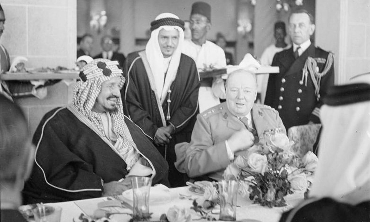 Winston Churchill sits with King 'Abd al-'Aziz Ibn Saud of Saudi Arabia during lunch at Auberge due Lac, Fayoum, in February 1945 | AP