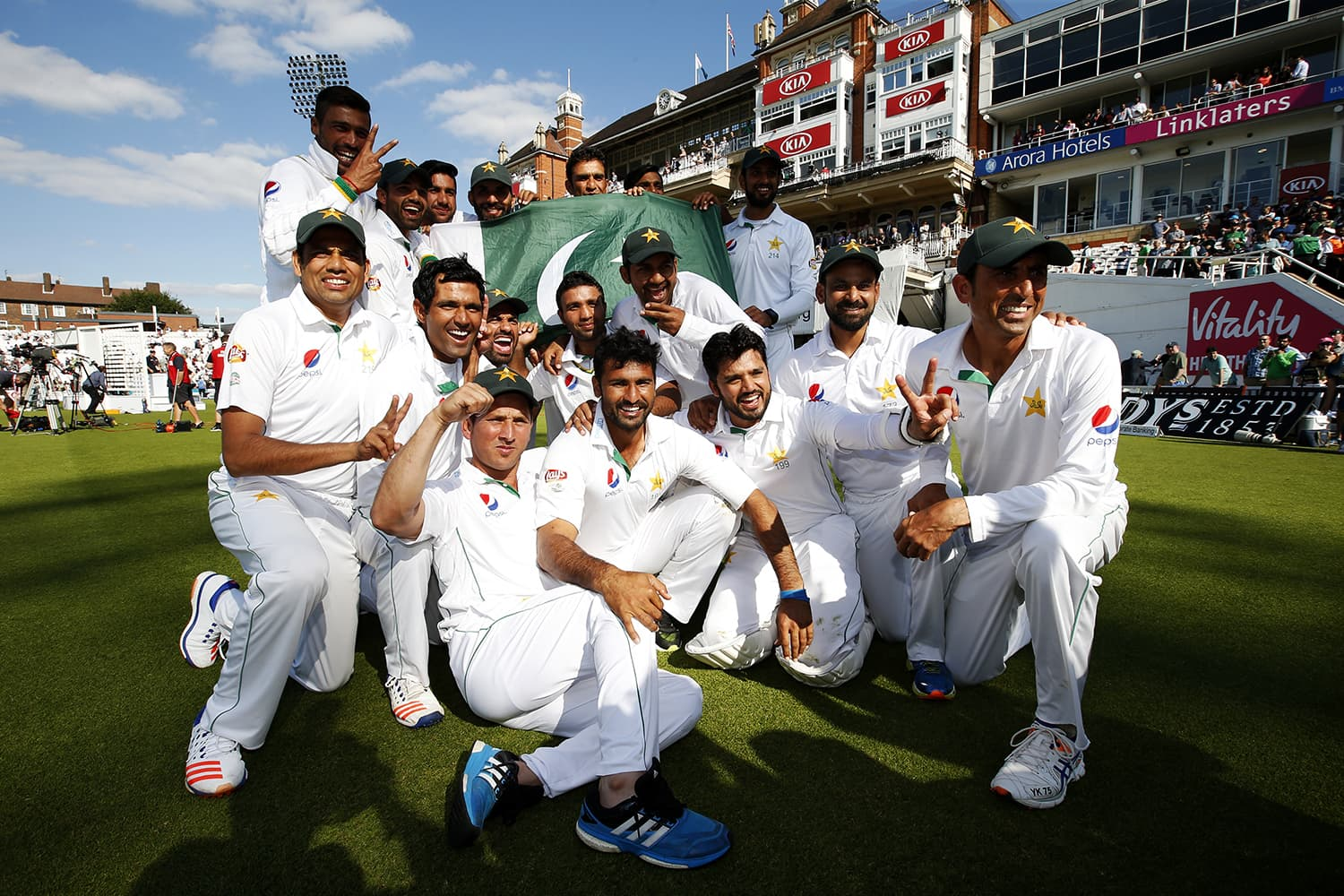 Pakistan celebrate their win. — Reuters