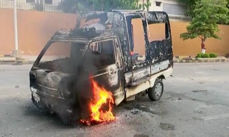 A police van set on fire during the protest — DawnNews screengrab