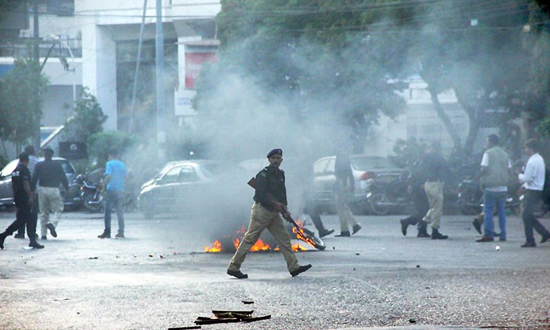 Policeman seen during clash between police and activists of MQM. —Online