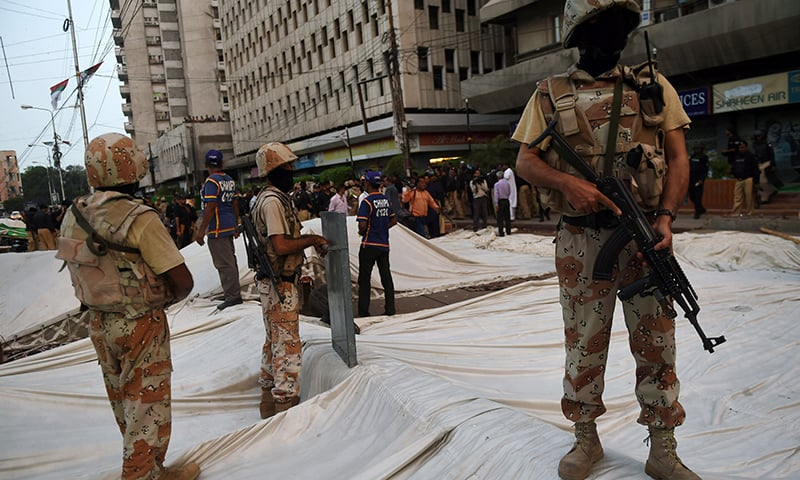 Rangers stand over a demolished hunger strike camp of MQM following a clash with police. —AFP