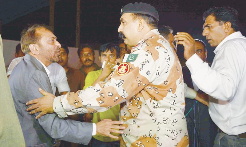 MQM leader Dr Farooq Sattar being taken into custody by Rangers personnel after he arrives at the Karachi Press Club to address a press conference on Monday.—INP