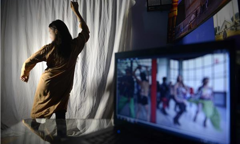 An aspiring Pakistani dancer practising her Bollywood dance moves in an academy in Lahore ─ AFP