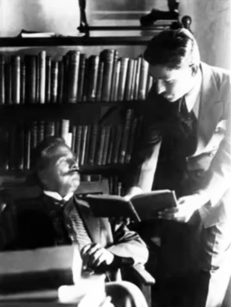 Iqbal (L) in his study.