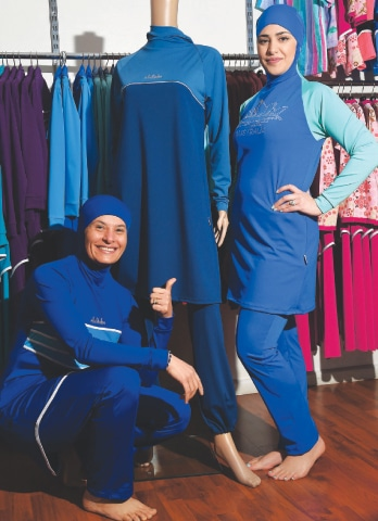 MODELS displaying burkini swimsuits in Sydney. Australian-Lebanese Aheda Zanetti, who claims the trademark on the name burkini and burqini and created her first swimwear for Muslim women more than a decade ago, said the furore in France has attracted more publicity for her products.—AFP