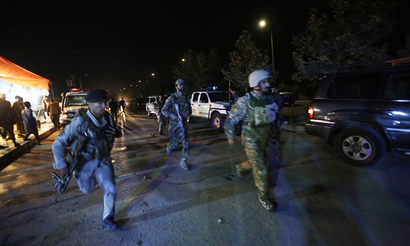 Afghan security forces rush to respond to a complex Taliban attack on the campus of the American University in the Afghan capital Kabul. — AP