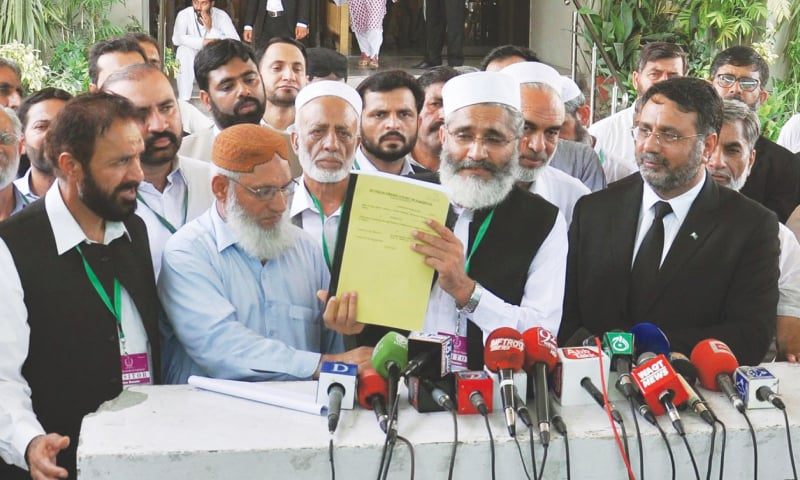 JI chief presents a copy of their petition to the media — Dawn