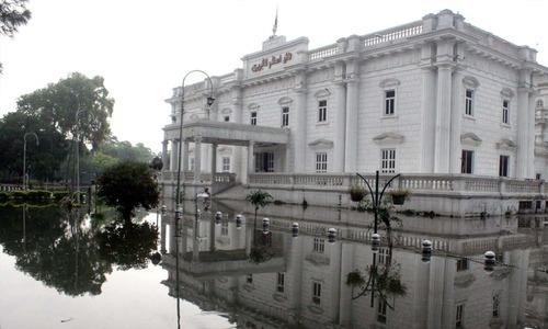 Rain water outside Quaid-i-Azam Library. —PPI
