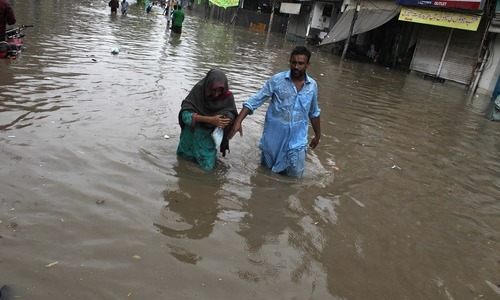 Senior citizens face difficulty due to rain. — AFP