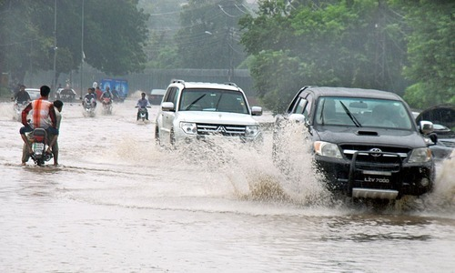 Vehicles on roads were half submerged in water.  —APP