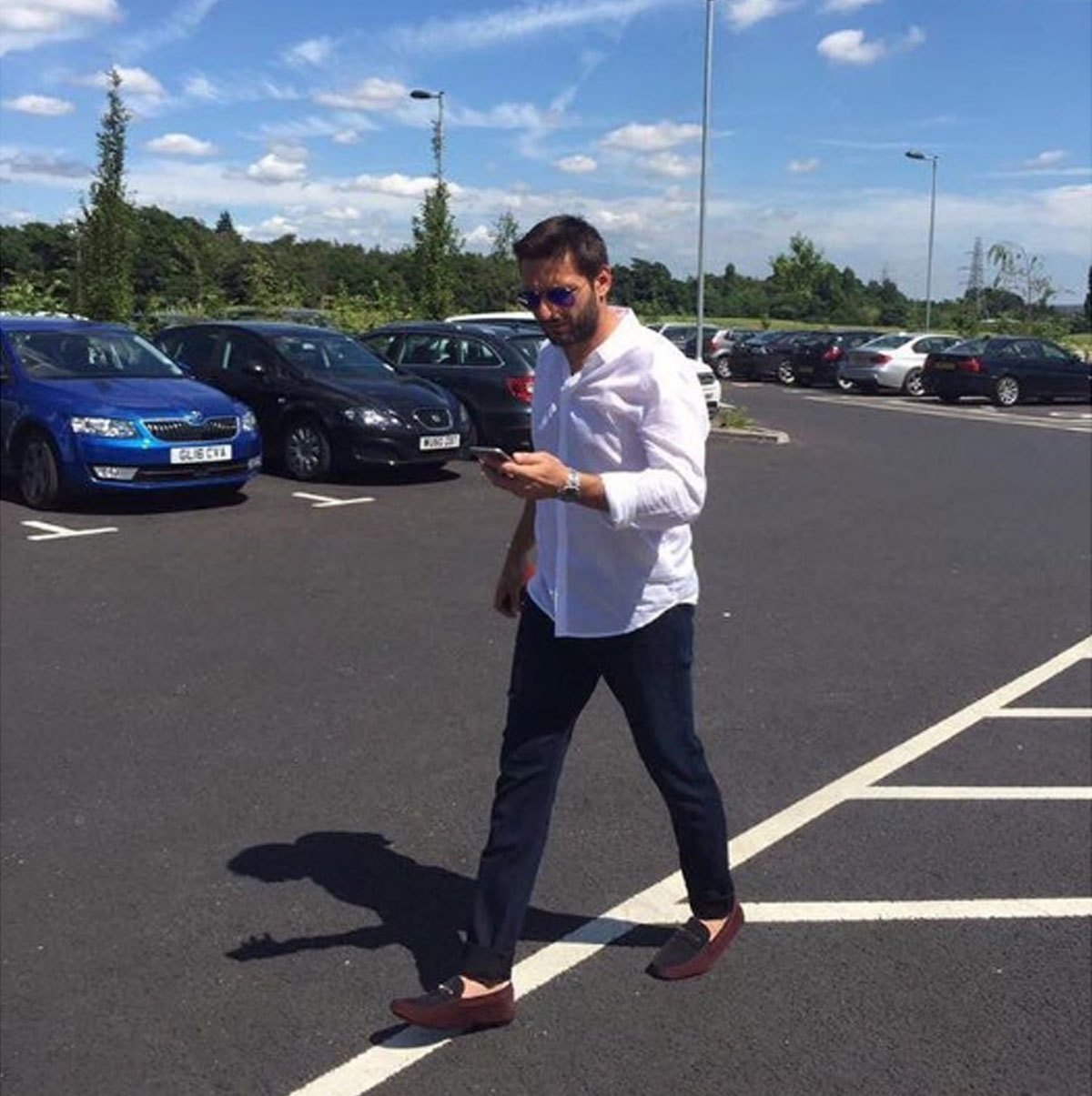 A quick run to the grocery store in a white button and jeans. - Instagram