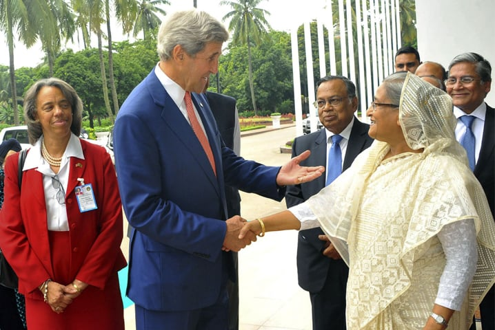 US Secretary of State John Kerry and Bangladesh Prime Minister Sheikh Hasina shake hands ahead of a meeting in Dhaka on Monday.—AFP