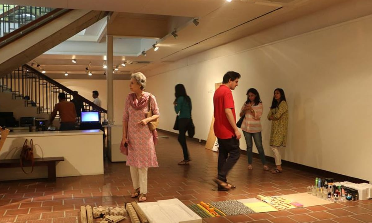 Visitors seeing Yasser Vayani's work, Linear (Im) Possibilities | Courtesy  IVS gallery
