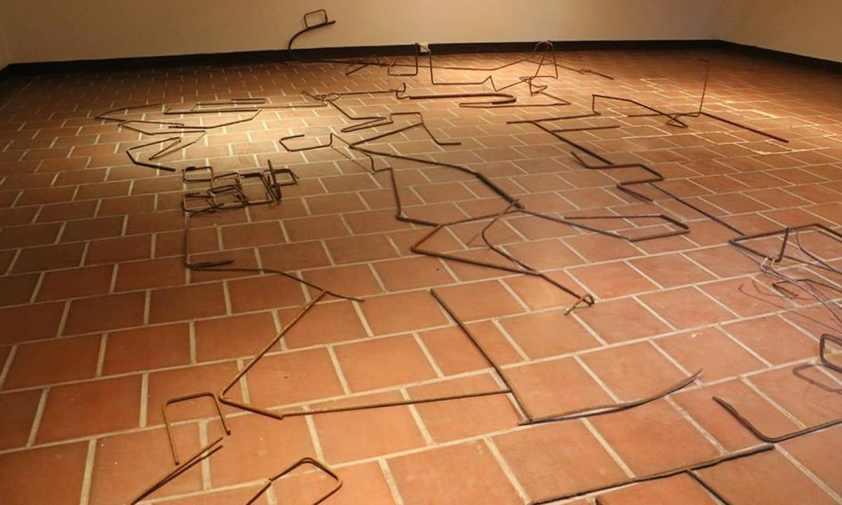 Yasser Vayani's piece titled Palindrome, uses rusted steel rods on a marble-tiled floor | Courtesy IVS gallery