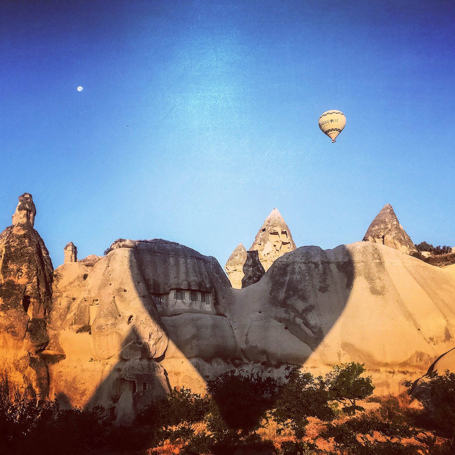Our balloon made a heart-shaped shadow over Pigeon Valley, Cappadocia.