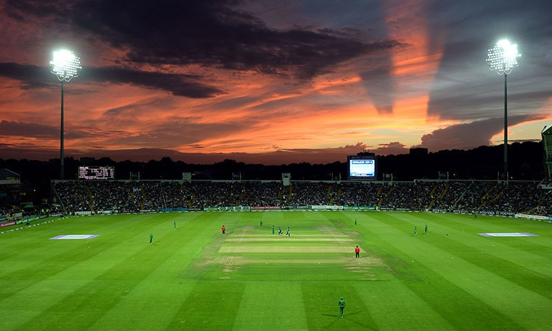 Sun sets at the Headingly cricket ground in Leeds — AFP