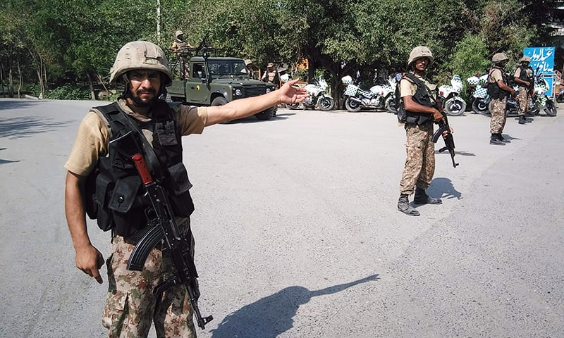 Soldiers cordon off a street leading to Christian colony.— AFP
