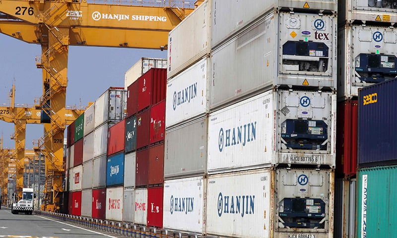 Containers are stacked up at a cargo terminal of Hanjin Shipping in the southeastern port city of Busan, South Korea ─ AP