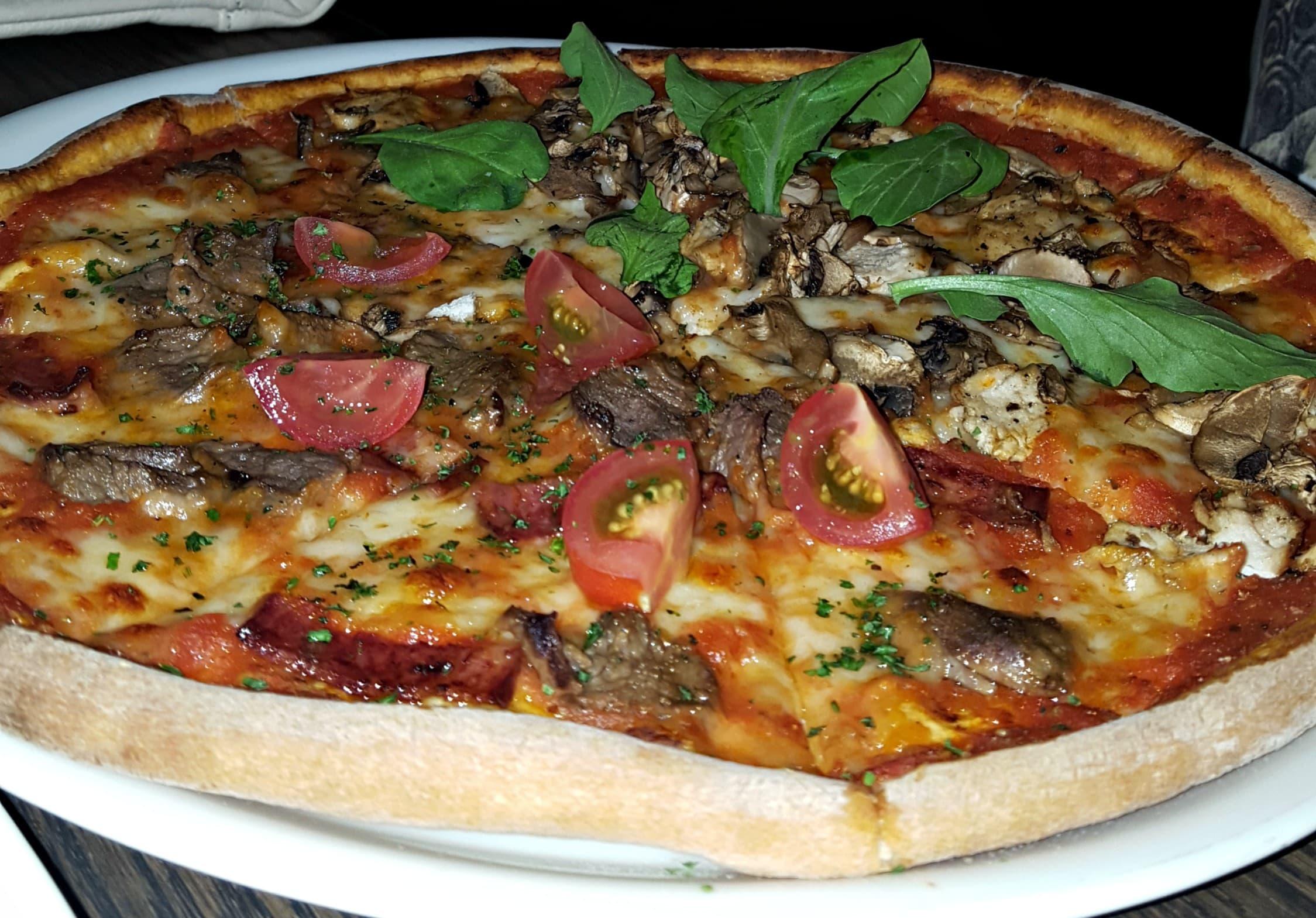 The pizzas are set apart by the buffalo mozzarella base