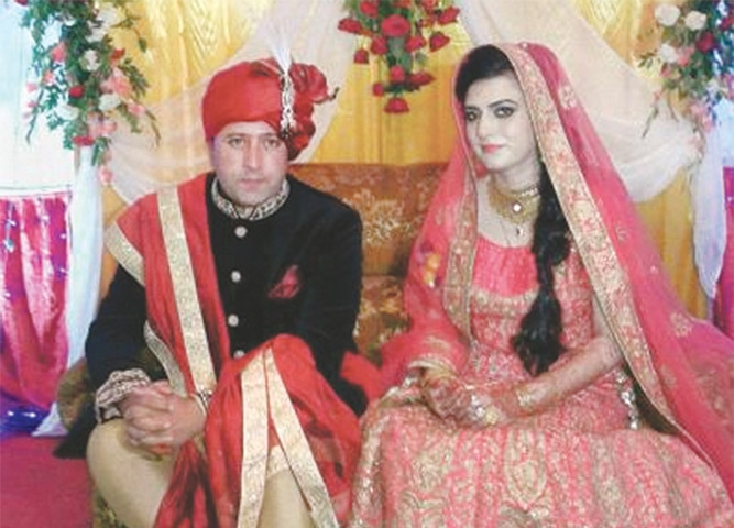 Owais and Faiza pictured at their wedding ceremony.