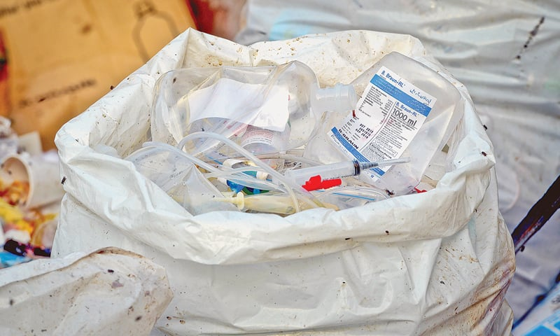 Used syringes and IV bags in the refuse at the JPMC.—White Star