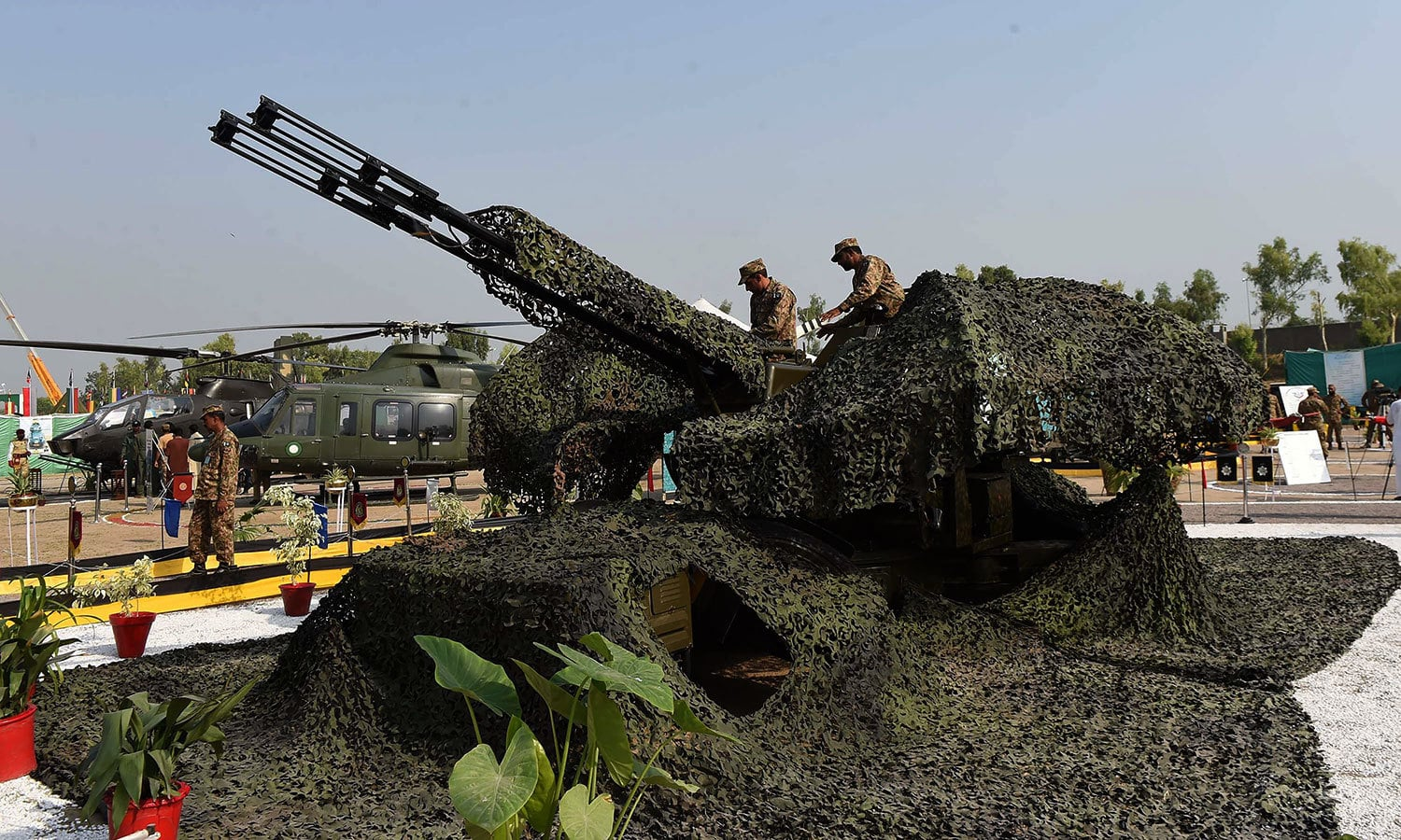 A camouflage anti-aircraft gun on display. — AFP