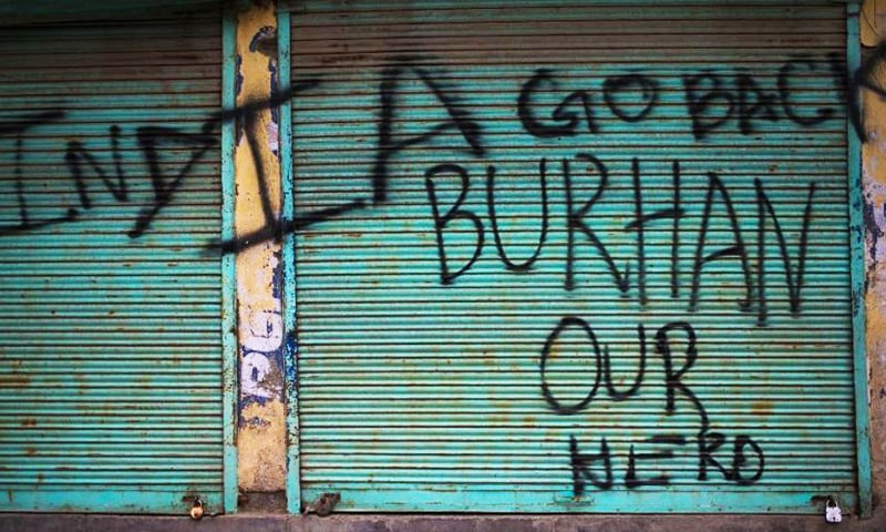 In this Aug 31, 2016, photo, graffiti eulogising militant commander Burhan Wani who was killed in July is painted on the shutters of shops in downtown Srinagar, IHK. ─ AP