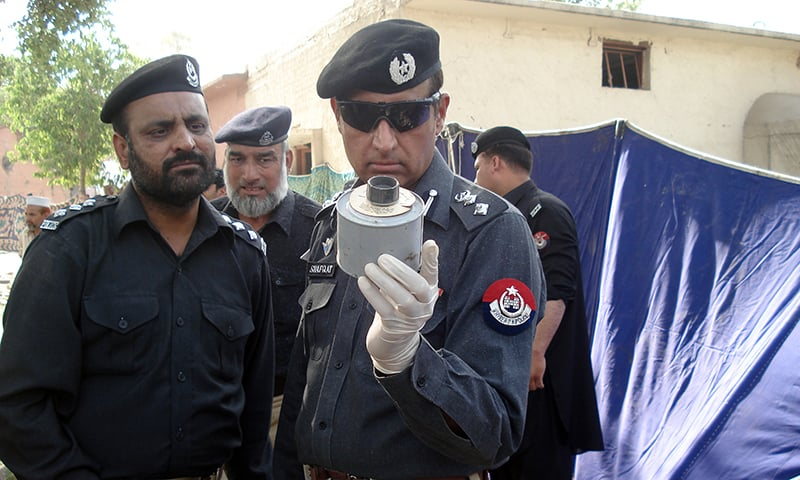 AIG Shafqat Malik inspects an IED at a crime scene.—Photo by author