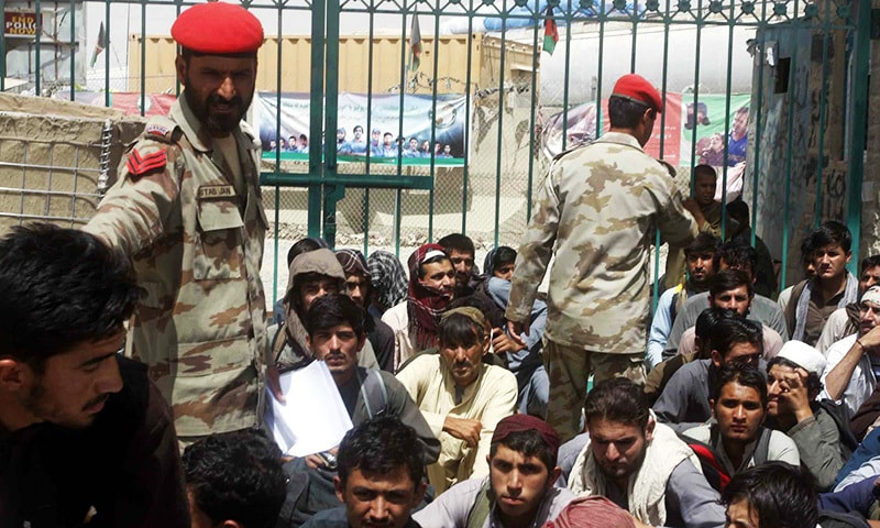 Afghan nationals arrested under the Foreigners Act are being  handed over to Afghan National Army personnel at Chaman border on Friday.— PPI