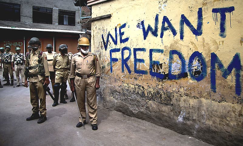 In this Aug. 12, 2016, file photo, Indian policemen stand guard during a curfew in Srinagar, India-held Kashmir. ─ AP