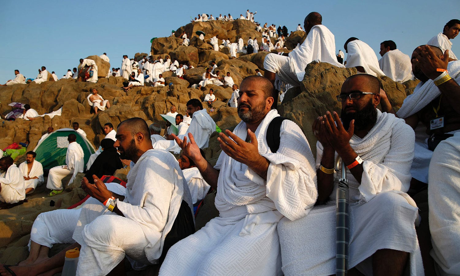 Pilgrims offer prayers during Haj at Mount Arafat . — AFP