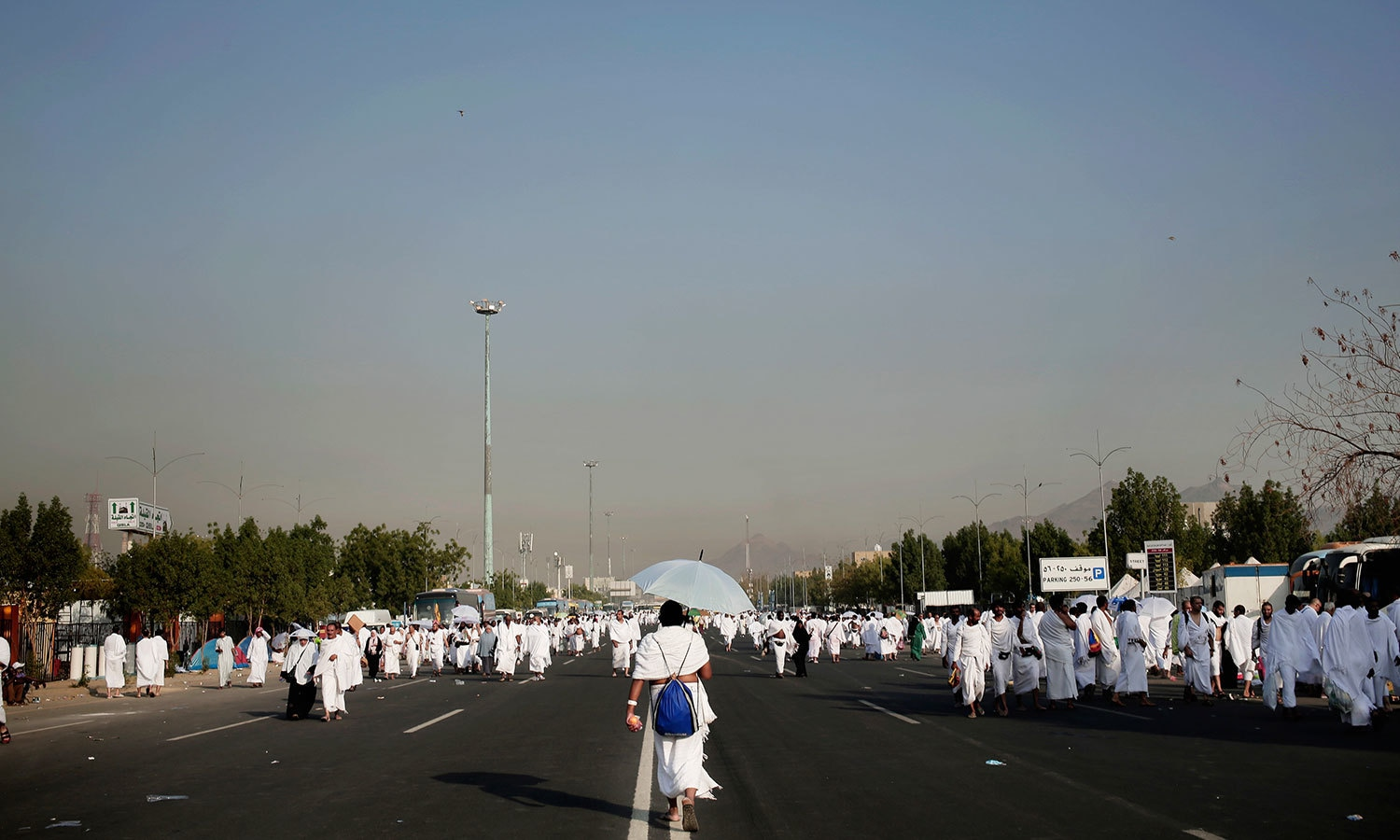 Pilgrims make their way in Arafat, during the annual Haj pilgrimage, near the holy city of Makkah. — AP