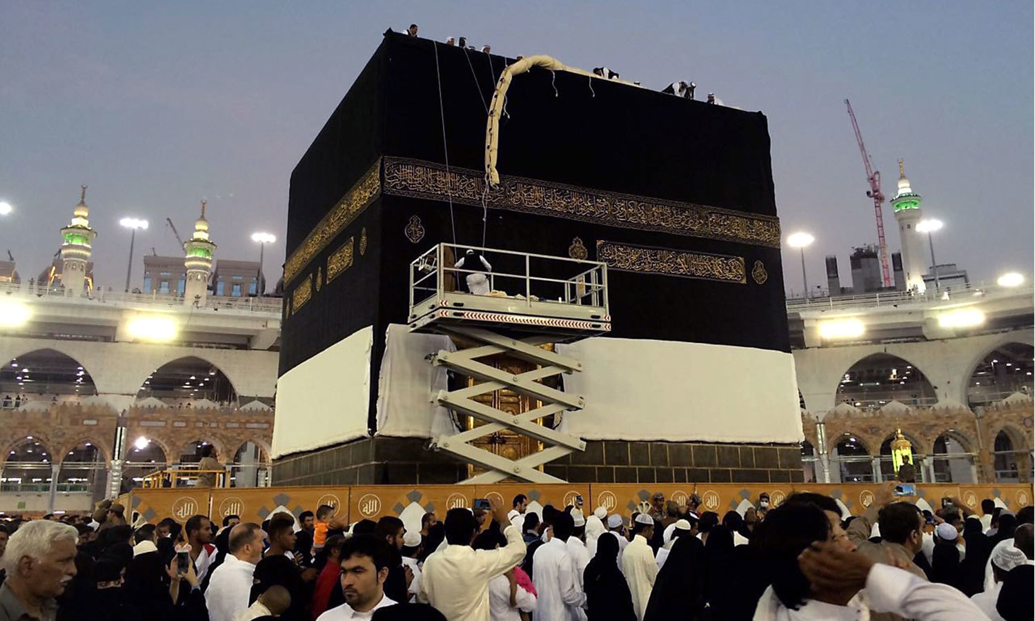 Saudi workers change the Kiswah (the cloth that covers the Kaaba) in Makkah, Saudi Arabia. — AP