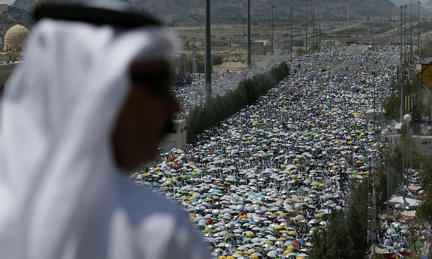 Pilgrims gather to perform noon and afternoon prayers at Namira Mosque in Mount Arafat, southeast of the Saudi holy city of Makkah. — AFP