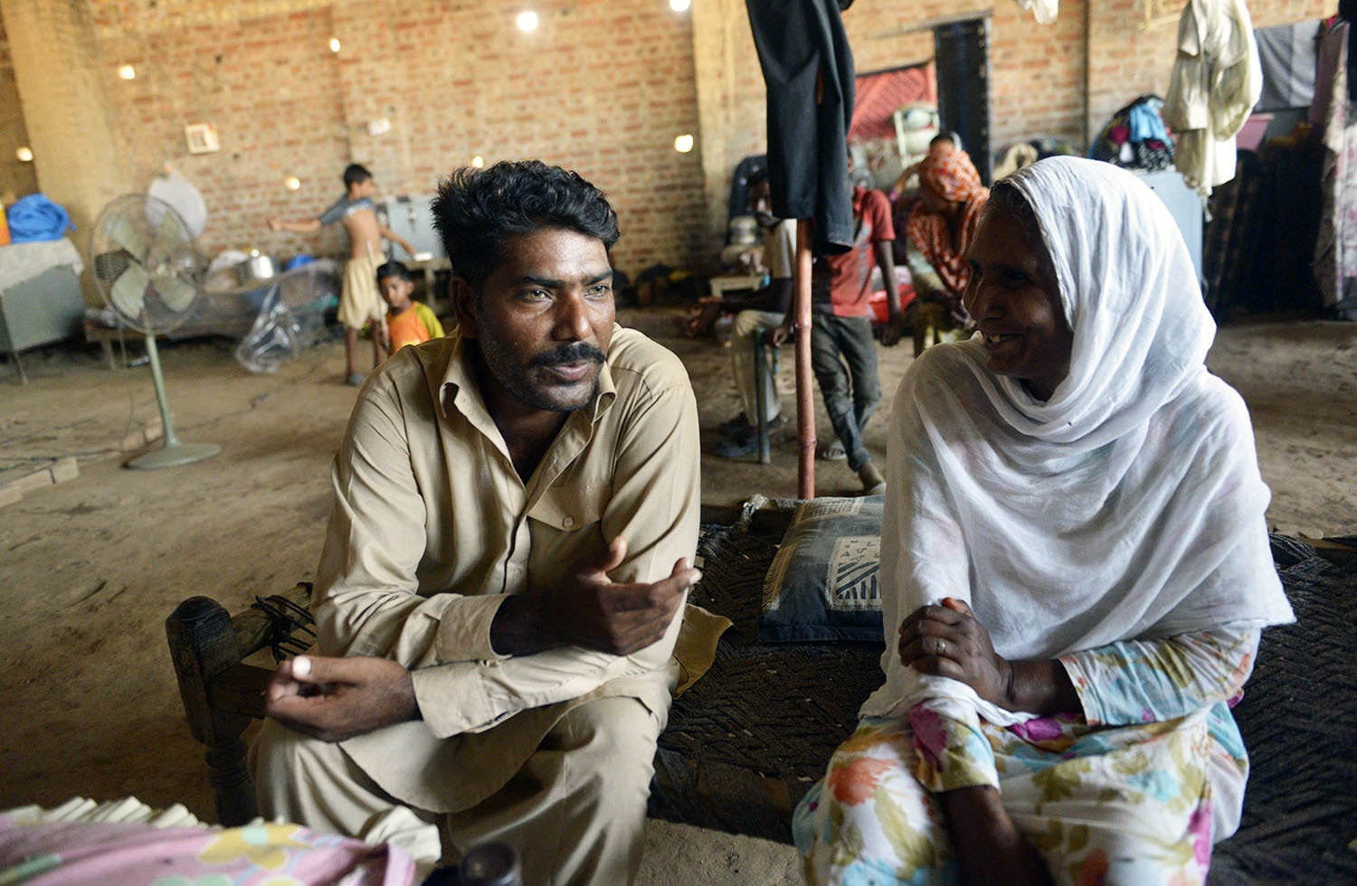 Ejaz, seen here with his mother, is a brick kiln worker in Lahore who sold his kidney 18 months ago.—White Star