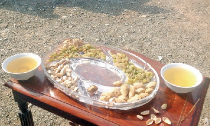 Serving guests with dry fruit, green tea a  special tribal Eid treat