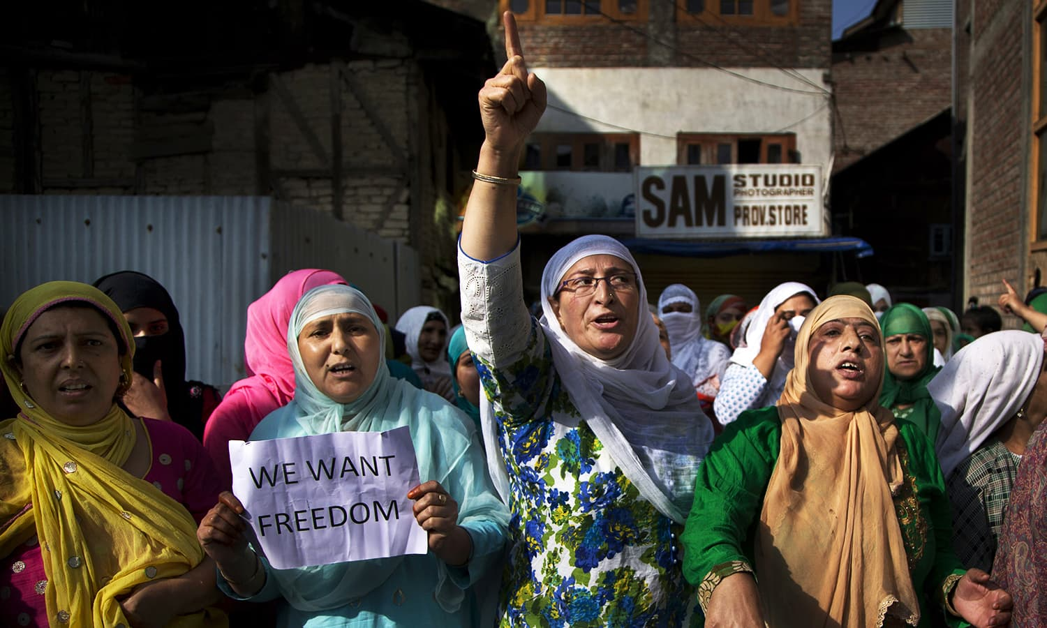 Kashmiri women shout freedom slogans during a protest after Eid prayers in Srinagar, India-held Kashmir, Tuesday, Sept. 13, 2016. ─ AP