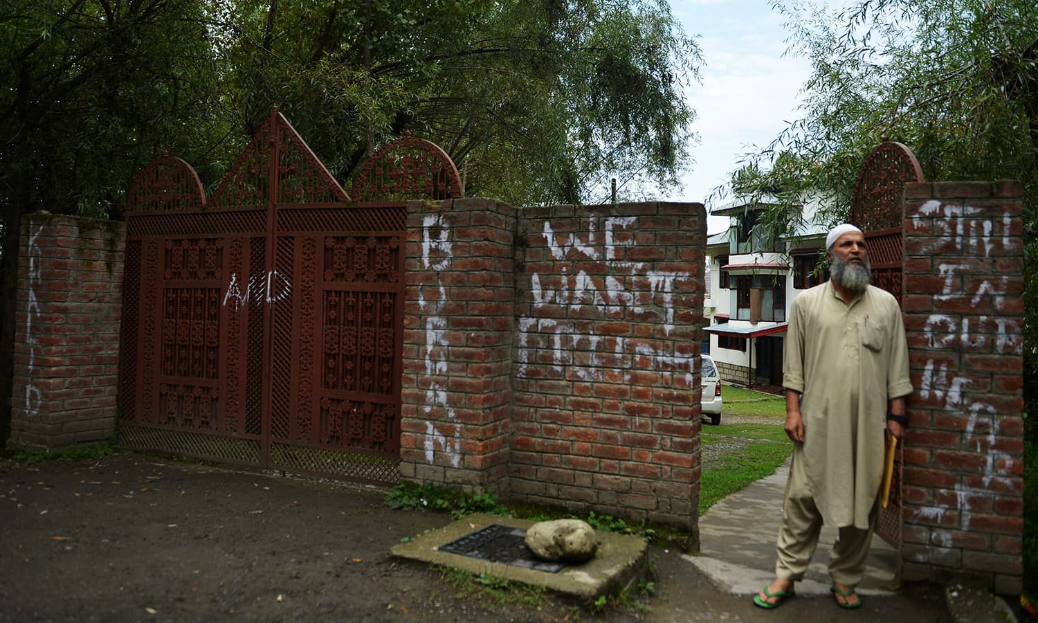 In this picture taken on September 12, 2016, Muzaffar Wani stands outside his home in Tral, a day before Eid. ─ AFP