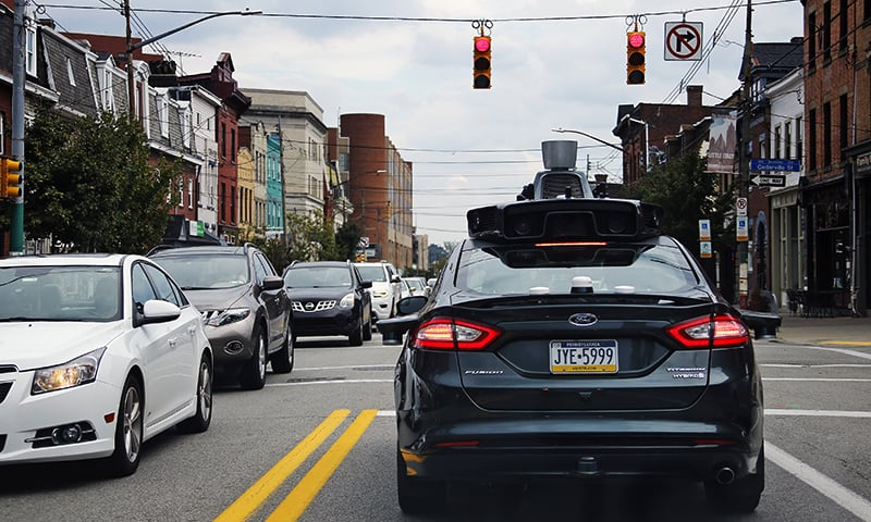 A self driving Uber car drives on Liberty Ave. through the Bloomfield neighborhood of Pittsburgh, Pennsylvania. — AP