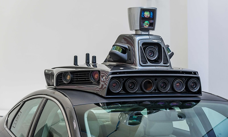 The cameras on a pilot model of an Uber self-driving car are displayed at the Uber Advanced Technologies Center in Pittsburgh, Pennsylvania. — AFP