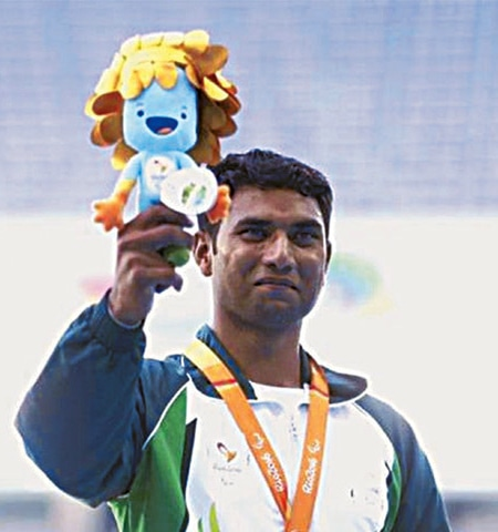 Pakistan's Haider Ali poses for a photo after winning the long jump bronze medal at the Paralympic Games.