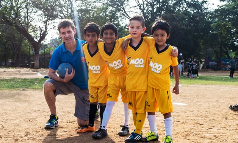 "American investment banker Eric Savage (left) often takes time off from work to train kids at Roots Football Academy, Bangalore as ""parent coach"". — Photo: Vishal Soman"