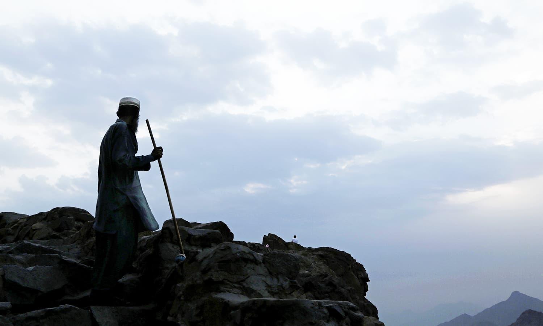 A Pakistan man cleans Noor Mountain.— AP