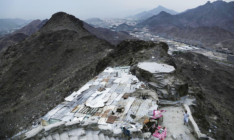 Pakistani men live near Hira cave on Noor Mountain.— AP